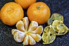 Mandarin orange fruit, peeled on a black background Royalty Free Stock Photo