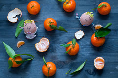 Mandarin orange fruit typical of winter with 2 nice eggs Royalty Free Stock Images
