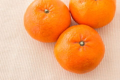 Mandarin orange. Group of mandarin orange on the fabric back ground Royalty Free Stock Photo