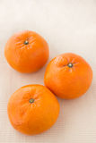 Mandarin orange. Group of mandarin orange on the fabric background Royalty Free Stock Photography
