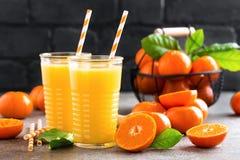 Mandarin orange juice. Refreshing summer drink. Fruit refreshment beverage. Closeup Stock Image