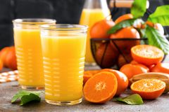 Mandarin orange juice. Refreshing summer drink. Fruit refreshment beverage. Closeup Royalty Free Stock Photos
