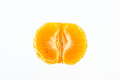 Mandarin orange peeled in half Stock Images