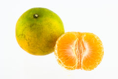 Mandarin orange peeled in half Royalty Free Stock Image