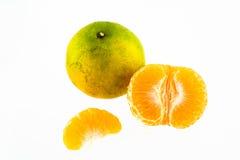 Mandarin orange peeled in half Royalty Free Stock Photos