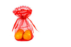 Mandarin orange and red net bag Royalty Free Stock Images