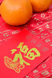 Mandarin orange and red packet Royalty Free Stock Images