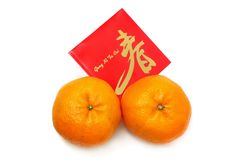 Mandarin Orange And Red Packet. Two mandarin oranges and red packet isolated over white background Stock Image