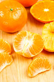 Mandarin Orange Sections on Cutting Board Royalty Free Stock Photos