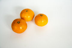 A mandarin orange. Under the background of a few white orange swing out of the shape of a very good material Royalty Free Stock Photography