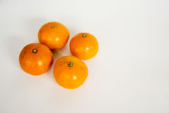 A mandarin orange. Under the background of a few white orange swing out of the shape of a very good material Stock Photo
