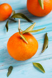 Mandarin oranges. Fresh mandarin oranges on wooden background Royalty Free Stock Image