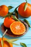 Mandarin oranges. Fresh mandarin oranges on wooden background Stock Photos