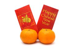 Mandarin Oranges And Red Packets Stock Image