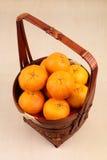 Mandarin oranges in basket Stock Photo