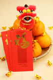 Mandarin oranges in basket with mini lion doll Royalty Free Stock Image