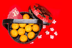 Mandarin oranges in basket with red envelope Good Luck character Stock Images