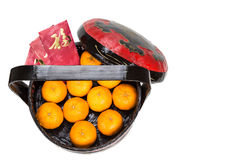 Mandarin oranges in basket with red envelope Good Luck character Royalty Free Stock Image