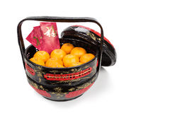 Mandarin oranges in basket with red envelope Good Luck character Stock Image