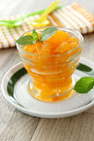 Mandarin oranges from  can in glass and mint leafs Royalty Free Stock Images