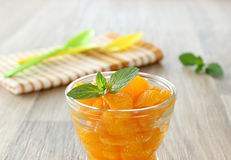 Mandarin oranges from a can in glass and mint leafs Royalty Free Stock Photos