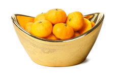 Mandarin oranges in Chinese gold ingot container Stock Photos