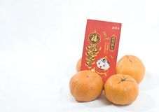 Mandarin oranges and Chinese New Year Red Packet Royalty Free Stock Images