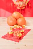 Mandarin oranges with Chinese new year red packets  (Foreign tex. T means All achievements Royalty Free Stock Images