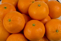 Mandarin oranges close up looking down Stock Photo