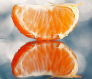 Mandarin oranges and cloves on blurred background Royalty Free Stock Images