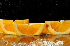Mandarin oranges and cloves on blurred Stock Image
