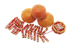 Mandarin Oranges and Firecrackers Stock Photo