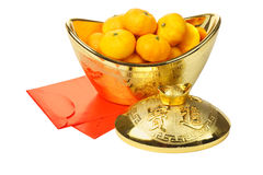 Mandarin Oranges in Gold Ingot and Red Packets Stock Photos