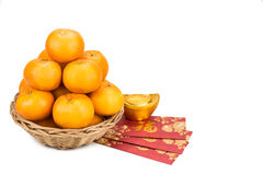 Mandarin oranges, gold nugget, red packets with good luck charac Royalty Free Stock Photo