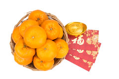 Mandarin oranges, gold nugget, red packets with good luck charac Royalty Free Stock Photos