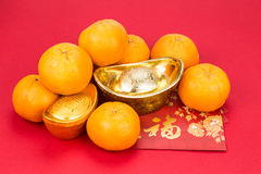 Mandarin oranges, gold nuggets, red packets, Chinese good luck c Royalty Free Stock Photo