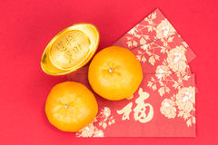 Mandarin oranges, gold nuggets, red packets, Chinese good luck c Stock Photo