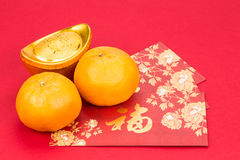 Mandarin oranges, gold nuggets, red packets, Chinese good luck c Royalty Free Stock Image