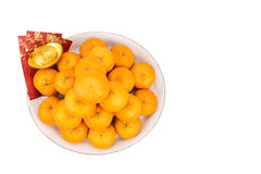 Mandarin oranges,  gold nuggets, red packets with good luck char Stock Photo