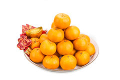 Mandarin oranges,  gold nuggets, red packets with good luck char Royalty Free Stock Images