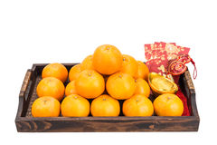 Mandarin oranges,  gold nuggets, red packets with good luck char Royalty Free Stock Photo