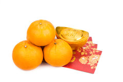 Mandarin oranges,  gold nuggets, red packets with good luck char Stock Image