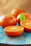 Mandarin oranges with leaves on a table Royalty Free Stock Image