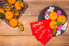 Mandarin oranges and Lunar New Year with text stock image