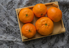 Mandarin Oranges - mandarin oranges. On a rustic wooden board stock images