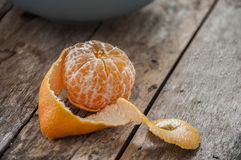 Mandarin Oranges - mandarin oranges on a rustic wooden board. Royalty Free Stock Images