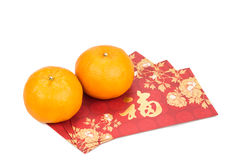 Mandarin oranges and red packets with Chinese good luck characte Royalty Free Stock Images