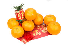 Mandarin oranges and red packets with Chinese good luck characte Stock Photos