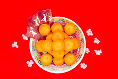 Mandarin oranges and red packets with Chinese Good Luck characte Stock Photo