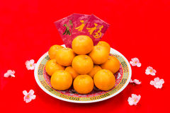 Mandarin oranges and red packets with Chinese Good Luck characte Royalty Free Stock Image